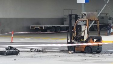 The burnt-out forklift.