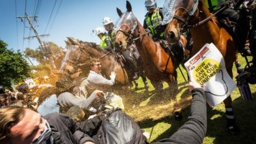 Members of the group No Room For Racism clash with police during the rally in Melton in November last year.
