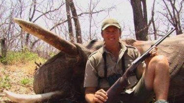 Glenn McGrath posing with dead wildlife in 2008.