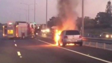 A car fire closed three lanes on the Pacific Motorway.
