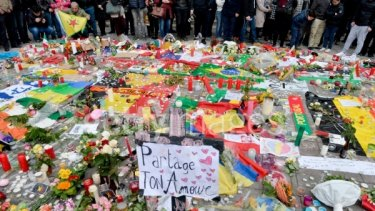 People gather at Place de la Bourse in Brussels in honour of the victims of Tuesdays' terror attacks.