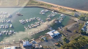 Smoke billows from a yacht at Compass Marina in Scarborough.