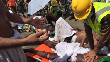 An emergency worker performs CPR on a pilgrim at Mecca.