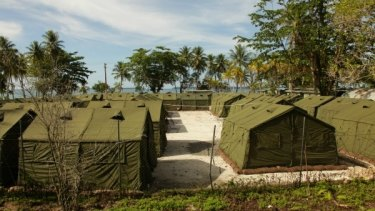 The PNG health minister has demanded answers from Manus Island contractors after the death of an asylum seeker.