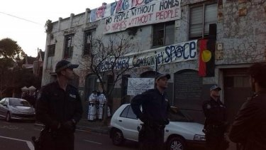 Police raid the building on Wilson Street, Newtown.