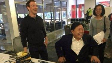 Mark Zuckerberg and China's internet regulator Lu Wei in California.