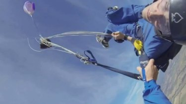 Shortly after the ripchord is pulled for him the trainee skydiver regains consciousness