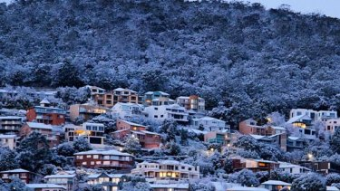 Snow blankets Hobart on Monday from the latest strong cold front to move across southern Australia.