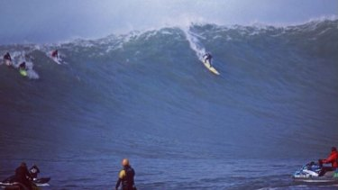 Shawn Dollar takes off on a 16.7-metre wave at Mavericks in 2010. The American big-wave surfer has broken his neck while competing at the Titans of Maverick competition.