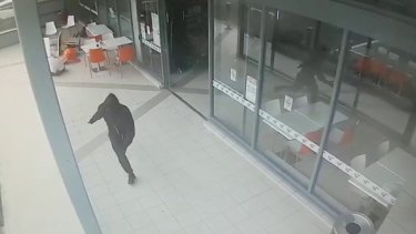 """CCTV shows the moment an unidentified killer fatally shot Walid """"Wally"""" Ahmad at a Bankstown shopping centre."""