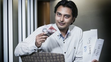 QUT researcher Dr Dhaval Vyas says middle income earners were still employing traditional thrifty methods such as dividing cash into envelopes for different expenses.