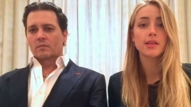 Johnny Depp and Amber Heard in their awkward apology video.