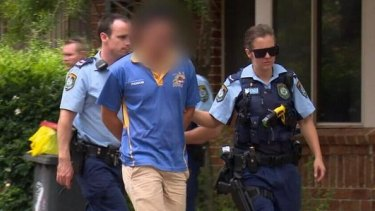 A 23-year-old man is arrested after a baby was found with burns to 40 per cent of his body in Sydney's west.