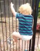 Brodie Atkinson climbs the fence.