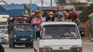 Thousands of workers every day cram together in trucks from the provinces to work in the many garment factories in Phnom Penh, Cambodia.