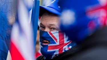A True Blue Crew member wears an Australian Flag on his face during a protest organized by the anti-Islam True Blue Crew supported by the United Patriots Front in Melbourne.