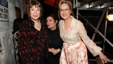 Carrie Fisher, centre, with Shirley Maclaine and Meryl Streep.