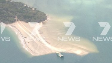 A picture from the Seven News chopper of the sinkhole that has formed at Inskip Point