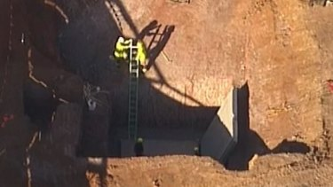 A concrete slab fell at Eagle Farm Racecourse, with reports two people were crushed.