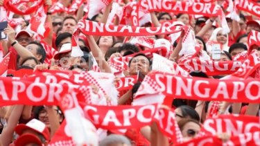 People take to the streets during Singapore's National Day Parade at Padang on Sunday.