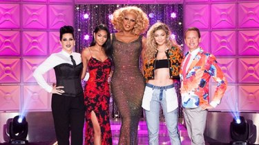 RuPaul (centre) with celebrity judges on <i>RuPaul's Drag Race</i>.