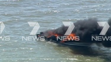 Flames tear through a boat in the southern Moreton Bay.