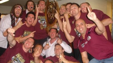 Robert Melhem, right with finger raised, celebrating with Manly players after they won the grand final in 2008.