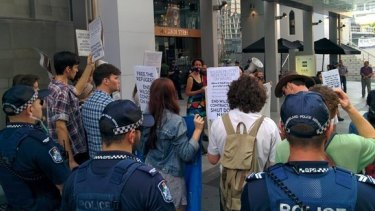 Protesters gather to campaign against Wilson Security's running of Australian detention centres.