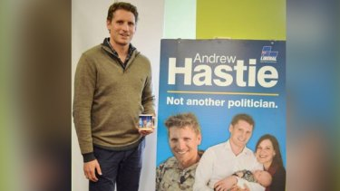 Canning MP Andrew Hastie was sacked from the Army Reserve after he refused to remove photos of himself in uniform from election campaign material.