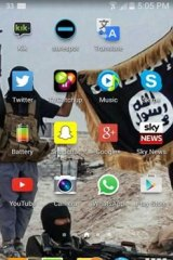 A wallpaper image from the boy's mobile phone showing Islamic State fighters.