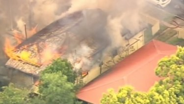 Firefighters are working to control a blaze at Ashgrove in Brisbane's north-west.
