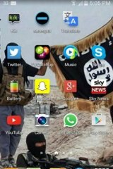 A wallpaper image from the English boy's mobile phone showing Islamic State fighters.