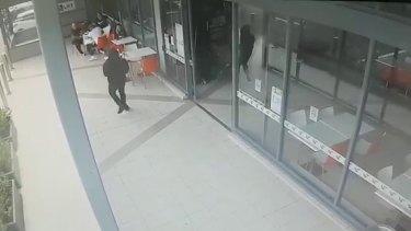 """CCTV shows the gunman approaching Walid """"Wally"""" Ahmad at Bankstown."""