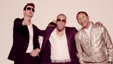 Happier times: Robin Thicke with Pharrell Williams and T.I in the <i>Blurred Lines</i> film clip.