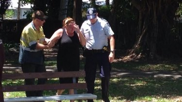Police and residents at the scene of the Cairns stabbing.