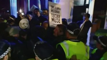 Protesters clash with police outside Pauline Hanson's campaign launch in Brisbane.