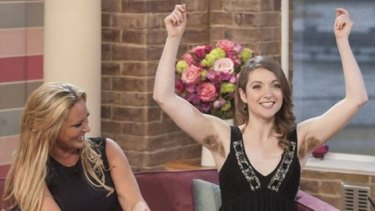 Emer O'Toole shows off her under arm hair on morning TV in the UK.