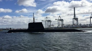 The submarine seen heading towards the West Gate Bridge.