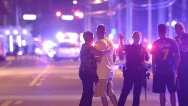 Police officers direct people away from the Pulse nightclub in Orlando.