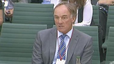 Former <i>News of the World</i> lawyer Tom Crone, pictured here giving evidence to a UK parliamentary inquiry.