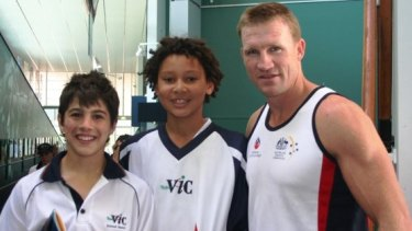 Stars of the future and young temammtes Christian Petracca and Ben Simmons with Collingwood coach Nathan Buckley.