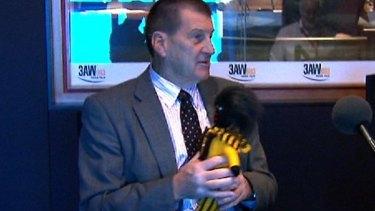 Hawthorn fan Jeff Kennett and his golliwog named ''Buddy'' after Buddy Franklin.