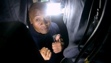 Surprise: Former All Black Jonah Lomu hides inside the booth.