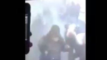 CCTV footage from Port Authority subway shows a plume of smoke and bystanders running for the exits.