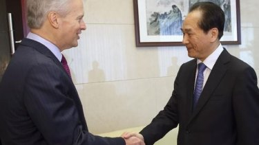 No deal, says Associated Press: Gary Pruitt, chief executive and president of AP meets Xinhua president Cai Mingzhao in Beijing on March 27.
