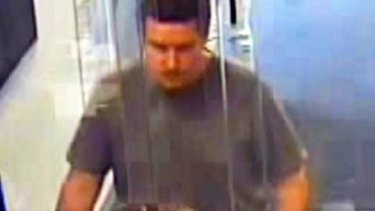 CCTV image of a man police believe to be Jonathan Dick at a bank in Melbourne's north.
