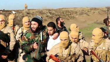 Islamic State militants with captured Jordanian pilot  Muath al-Kasasbeh.