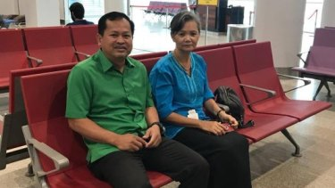Respected Cambodian opposition figure Mu Sochua, right,  in the departure hall of Phnom Penh's airport before leaving the country, saying she had been told her arrest was imminent.