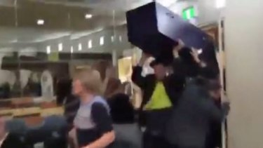 Far-right protesters disrupt Moreland's council meeting brandishing a fake coffin.
