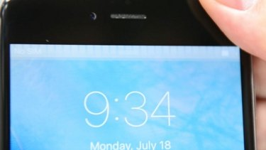 """A grey flickering bar across the top of the iPhone screen is a symptom of the so-called """"touch disease""""."""